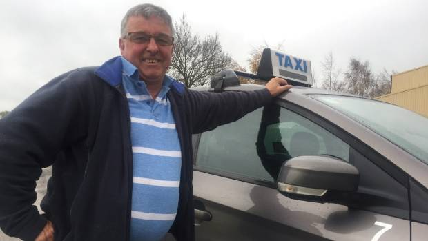 David Chinnery-Brown stands next to his taxi in Carterton.