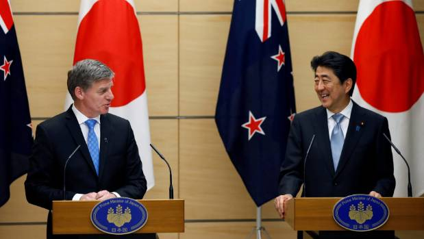 New Zealand Prime Minister Bill English (L) and Japan's Prime Minister Shinzo Abe attend a joint news conference at ...