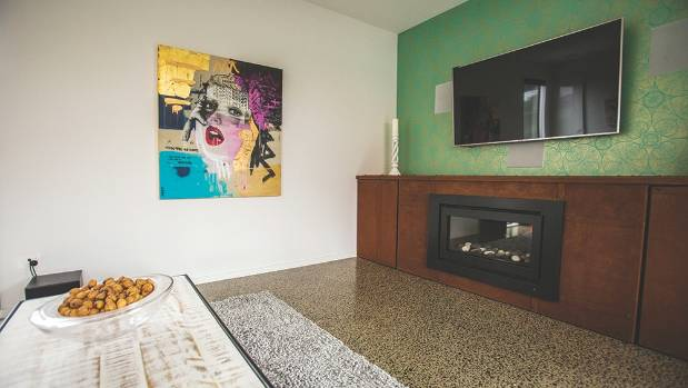 A polish concrete floor runs the length of the ground-floor living areas.