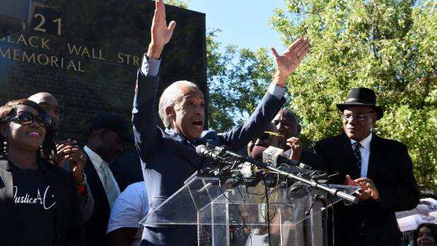 Reverend Al Sharpton raises his hands while speaking to protesters before a peaceful 2016 march for Terence Crutcher, ...
