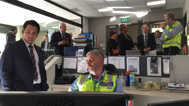 Transport Minister Simon Bridges talks to Lyttelton tunnel control officer Keith Shipston after he announced a $28m ...