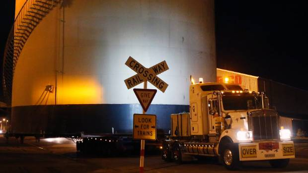The 80-tonne tank was so wide signage had to be removed from rail crossing to allow it to pass.