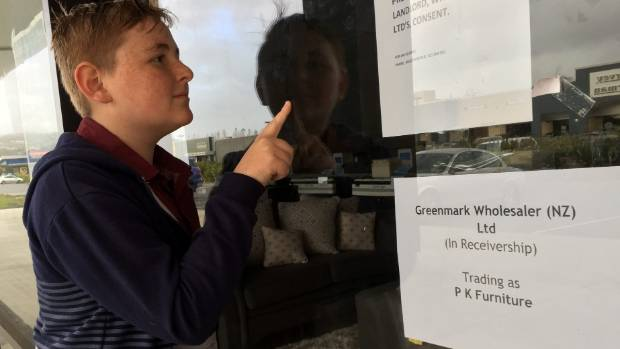 Pukekohe's Aidan Toop looks into PK Furniture in Pukekohe - he can see the bookcase his grandpa bought for him.