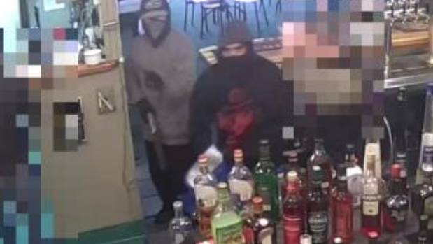 Two men armed with shotguns robbed a bar on Great North Rd Wednesday morning.