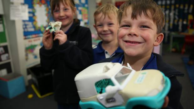 Ruby Challis, Tomas Clark and Sam Horrell, all 5, playing with a truck at Hauroko Valley Primary School for Discovery Time.