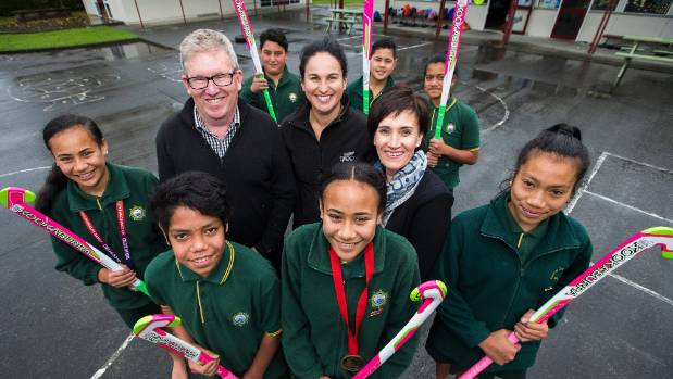 John Turkington, centre left, with Black Stick Kayla Whitelock and Angela Turkington, surrounded by James Cook School ...