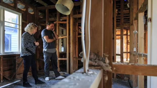 Scott and Rodgers in what remains of a bedroom in their home.