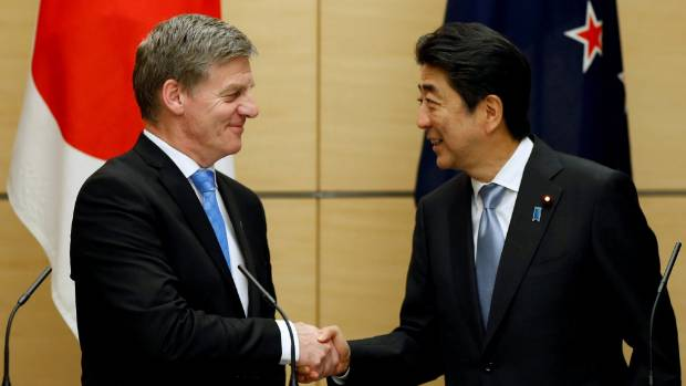 Prime Minister Bill English (left) and Japan's Prime Minister Shinzo Abe before they signed a deal reviving the Trans ...