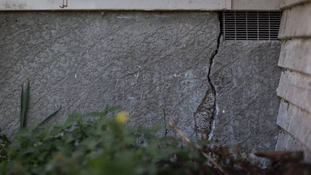 A cracked foundation in the couple's earthquake and fire damaged home.