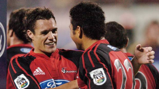 Crusaders first-five eighth Dan Carter congratulates team mate Casey Laulala after scoring against the Highlanders in ...