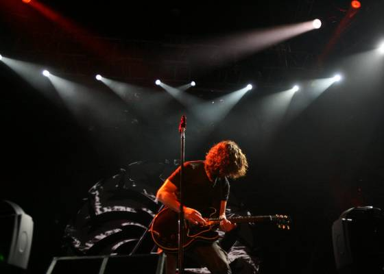 Cornell plays guitar for an excited NZ crowd in 2012.