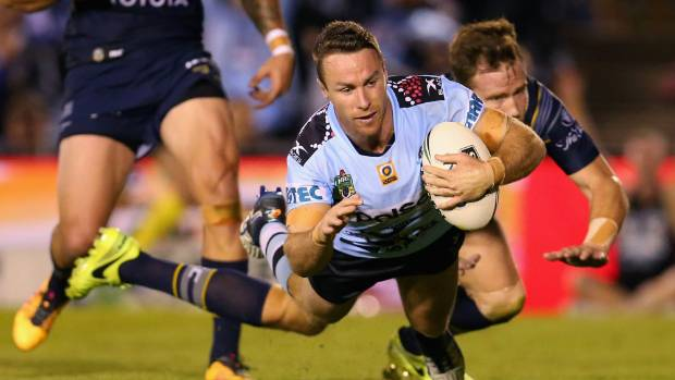 James Maloney dives over to score one of the Cronulla Sharks' three second-half tries to snatch victory from the North ...