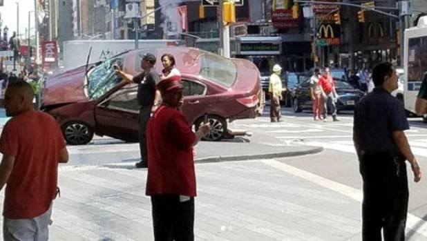 The vehicle that was driven into pedestrians at New York's Times Square came to rest after crashing into a pole on ...