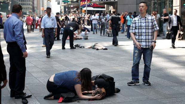 Injured people are seen on the sidewalk in New York's Times Square after a speeding vehicle struck pedestrians.