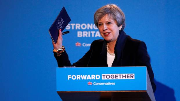 "Britain's Prime Minister Theresa May said Britain had ""a chance to step back and ask ourselves what kind of country we ..."