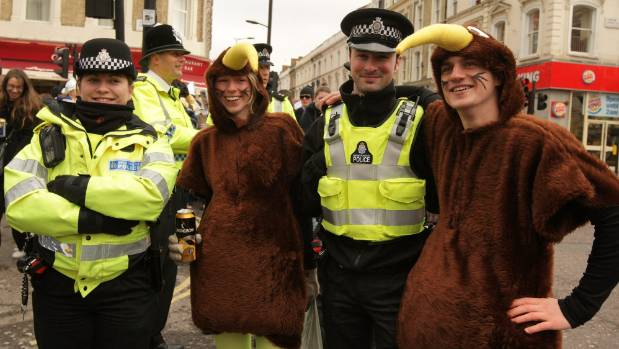 New Zealanders dressed in Kiwi costumes pose with police officers as they celebrate Waitangi Day in London. (File photo)