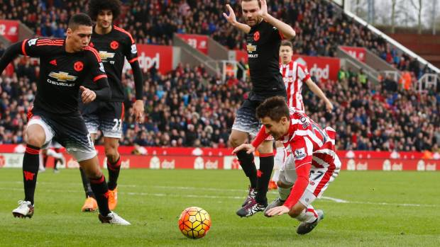 Stoke's Bojan Krkic goes down before being shown a yellow card for diving in an EPL match against Manchester United.