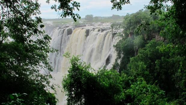 Victoria Falls on the Zambezi River which forms the border between Zambia and Zimbabwe.