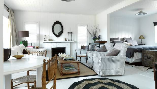 The two rugs in the living area were put down to protect the white flooring.