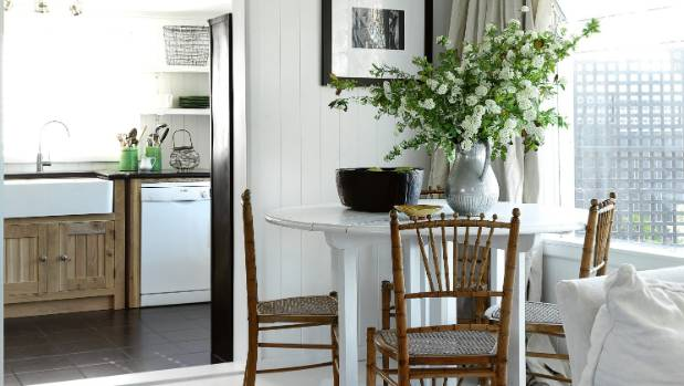 The white table in Tina Symmans' Hawke's Bay cottage is from Redcurrent; the wooden chairs were bought from a friend.