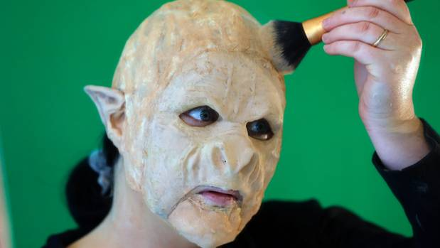 "Sarah Dow, 36 said it took her eight hours to apply a full face of prosthetics and makeup to create the ""Orc"" design."