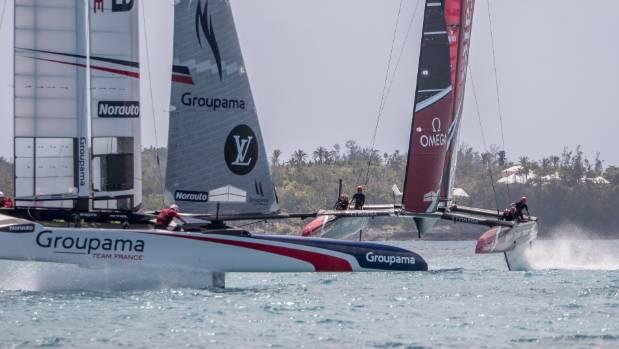 Team New Zealand bear down on Team France during practice racing in Bermuda.