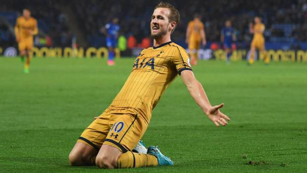 Harry Kane of Tottenham Hotspur celebrates as he scores their fifth goal and completes his hat-trick.