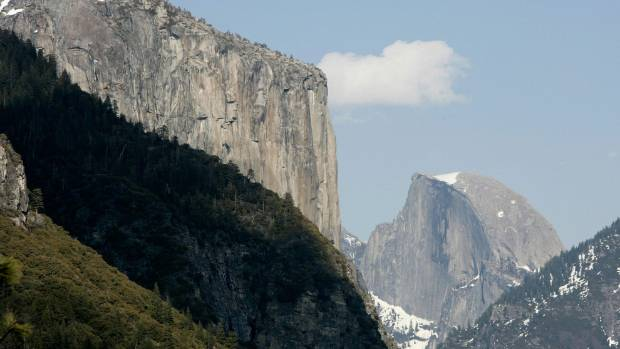 The world-famous granite monolith of El Capitan (L) and Half Dome (R), in Yosemite National Park .