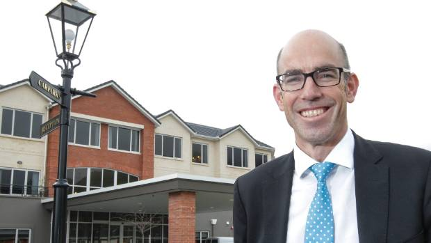 Ryman's Simon Challies, seen here outside the Charles Fleming village in Waikanae, plans to step down in June.