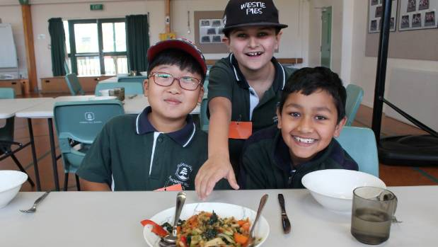 Forrest Hill School pupils Andy Kim, Dominic Smith and Aabid Mehdi get excited about eating what they have created in ...