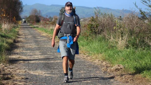Mark Kerr walks along the scenic Hauraki Rail Trail near Paeroa as part of his  journey the length of the country to ...