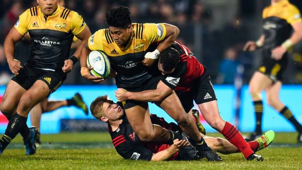 Julian Savea is tackled by Jack Goodhue and Ryan Crotty last Saturday.