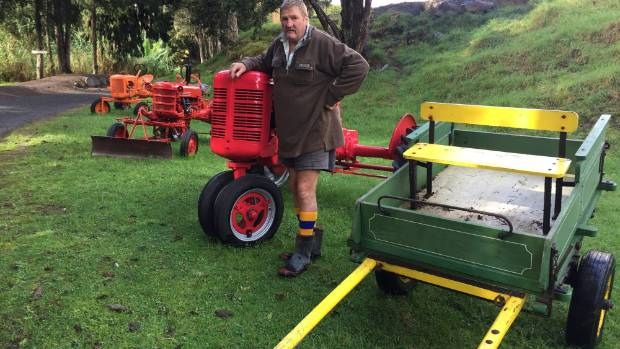 Snow Harrison with farming equipment that will be on display in the 150th commemorations of Okaihau.