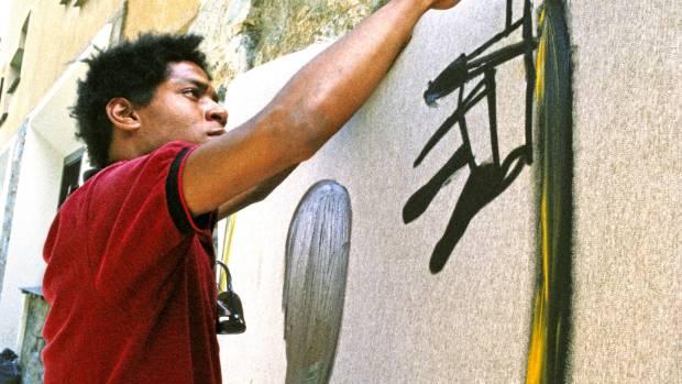 Artist Jean-Michel Basquiat painting in 1983 in St. Moritz, Switzerland.