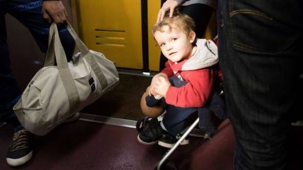 It is standing room only for three-year-old Taylor Fearnley and his mother Kylie on a Sunday morning train from Central ...
