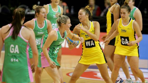 Netball South's Hayley Crofts, in green, challenges Central's Mila Reuelu-Buchanan for the ball in the national ...
