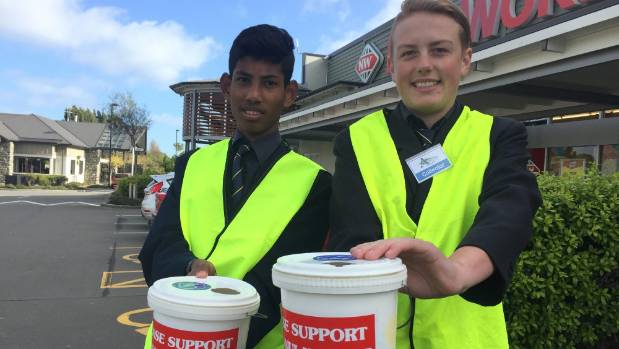 Freyberg High School pupils O-Zaing Yenat, 15, left, and Joel Turnbull, 14, spend their Friday fundraising money for ...