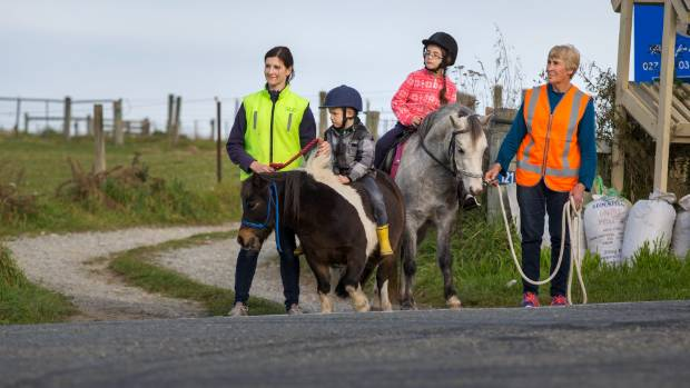 Checking the road is clear before crossing are, from left, Averil Coleman, Noah Coleman, 6, Sophie Coleman, 7, and Linda ...
