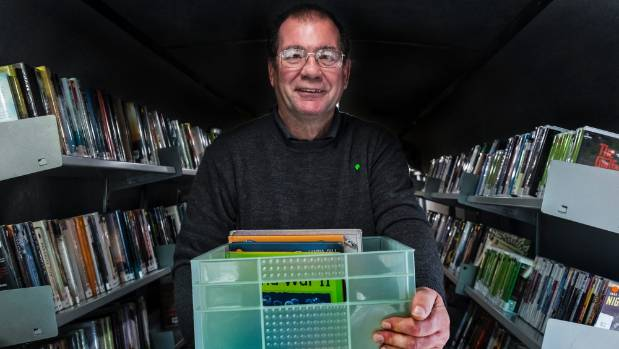 Mobile librarian Gordon Ross in his new book bus ready to spread the word.
