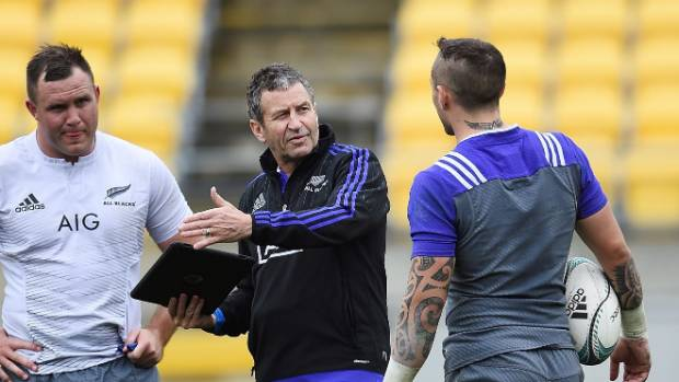 Wayne Smith, centre, provides TJ Perenara, right, with a few pointers.