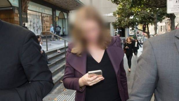 The woman, who cannot be identified, leaves the Downing Centre court complex.