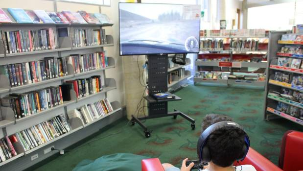 Tyreese Bennett-James, 9, tries out the new PlayStation 4 at the Ruth Gotlieb Kilbirnie Library, where it is available ...