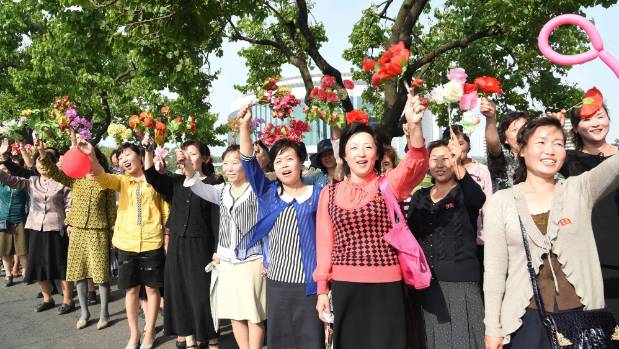 People cheer as missile developers arrive in Pyongyang, North Korea.