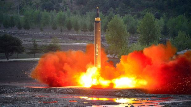 The long-range strategic ballistic rocket Hwasong-12 (Mars-12) is launched during a test in this undated photo released ...