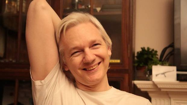Julian Assange is all smiles after learning a rape investigation into him has been dropped.