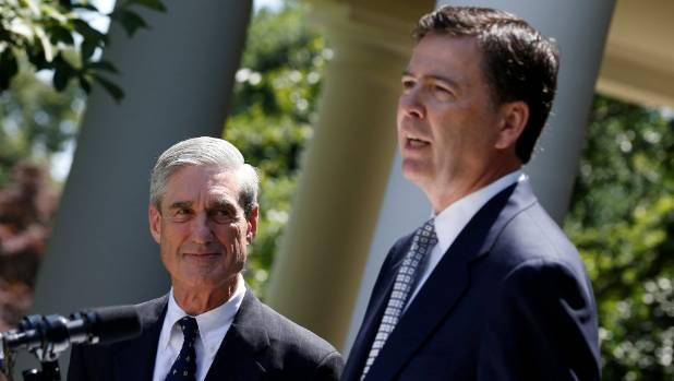 Then-incoming FBI director James Comey, right, speaks alongside outgoing FBI director Robert Mueller in June 2013. [FILE ...