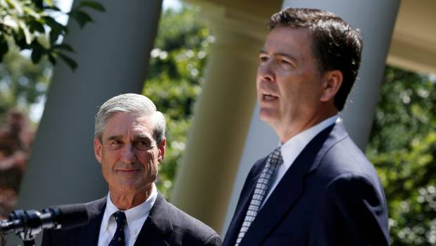 Former FBI Director James Comey, front, with Robert Mueller, who was this week appointed as a special prosecutor to ...