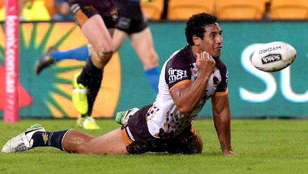 Tautau Moga slides over to score the first of six Brisbane Broncos tries in their 36-0 rout of the Wests Tigers.