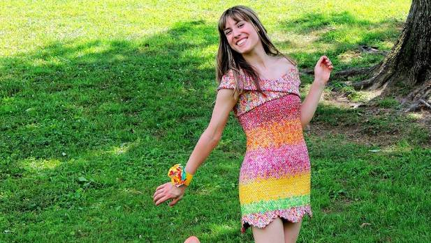 It took Emily Seilhamer four years - and 10,000 Starburst wrappers - to make the dress.