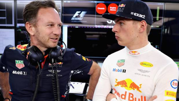 Max Verstappen of the Netherlands, right, with Red Bull Racing Team Principal Christian Horner in the garage. Verstappen ...